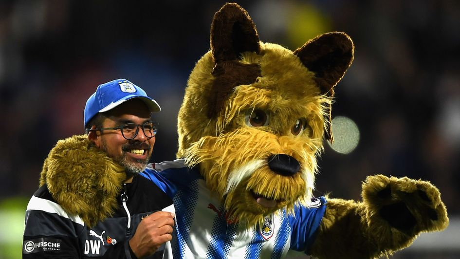 David Wagner (left) and Terry the Terrier celebrate