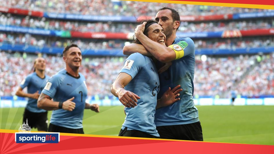 Edinson Cavani celebrates with teammate Diego Godin after scoring Uruguay's third against Russia
