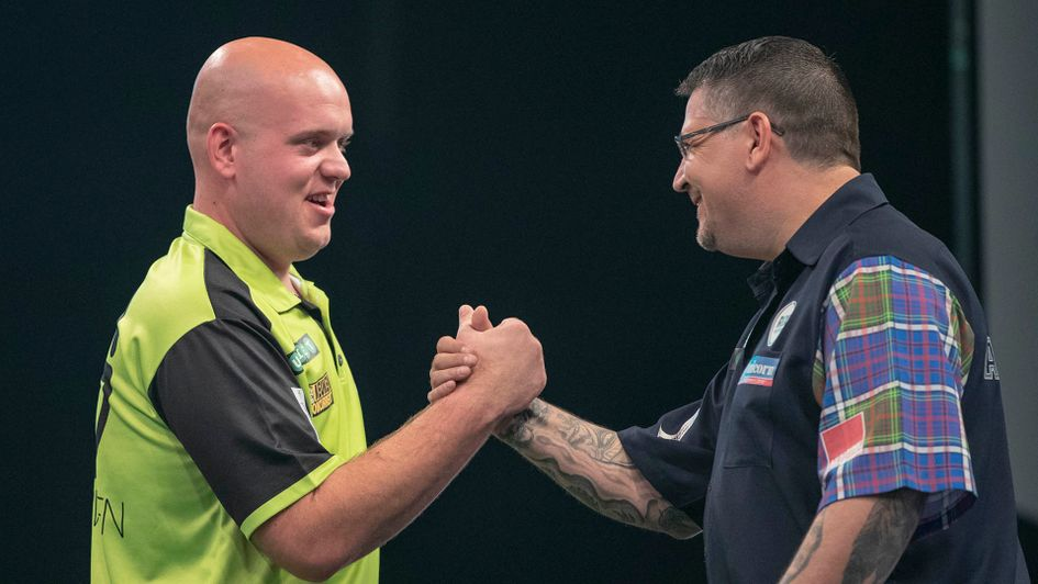 Michael van Gerwen and Gary Anderson shake hands (Picture: Lawrence Lustig/PDC)