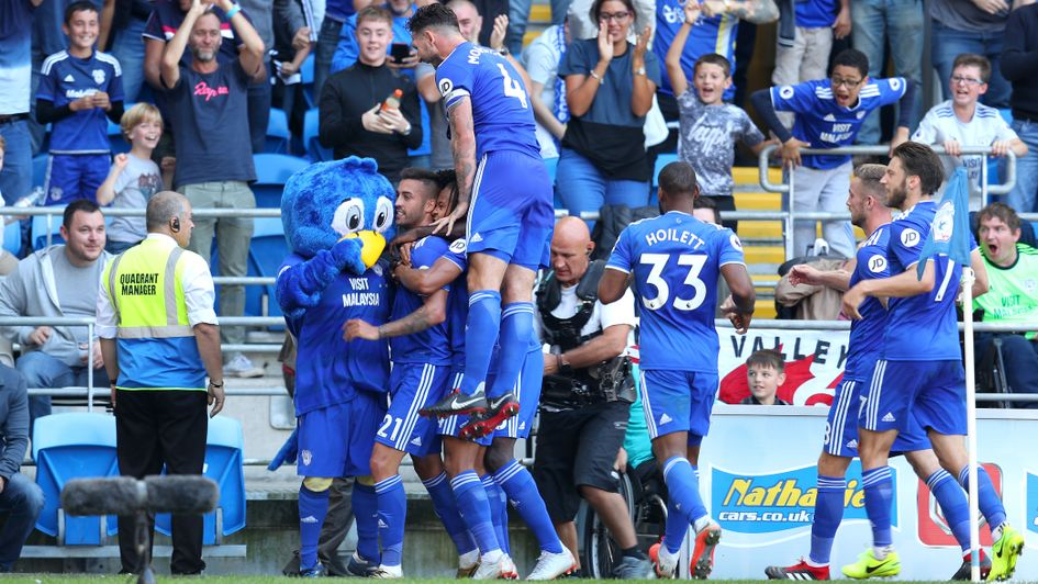 Victor Camarasa celebrates with his team-mates after scoring for Cardiff