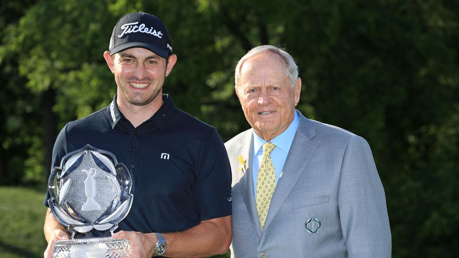 Patrick Cantlay is presented with the trophy by Jack Nicklaus