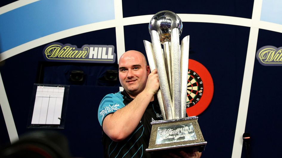 Rob Cross celebrates with the Sid Waddell trophy