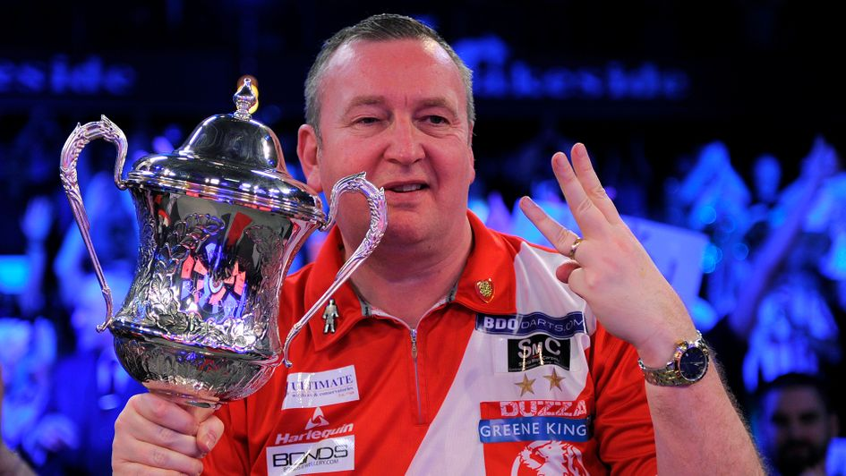 Glen Durrant holds the Lakeside trophy for the third year in a row