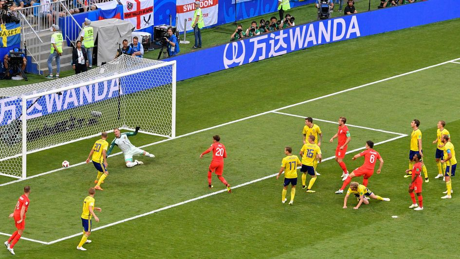 Harry Maguire heads home for England against Sweden at the World Cup