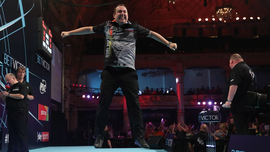 Kim Huybrechts jumps for joy (Picture: PDC/Lawrence Lustig)