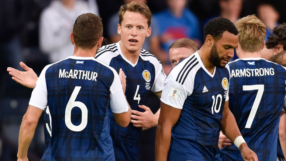Christophe Berra and Scotland celebrate