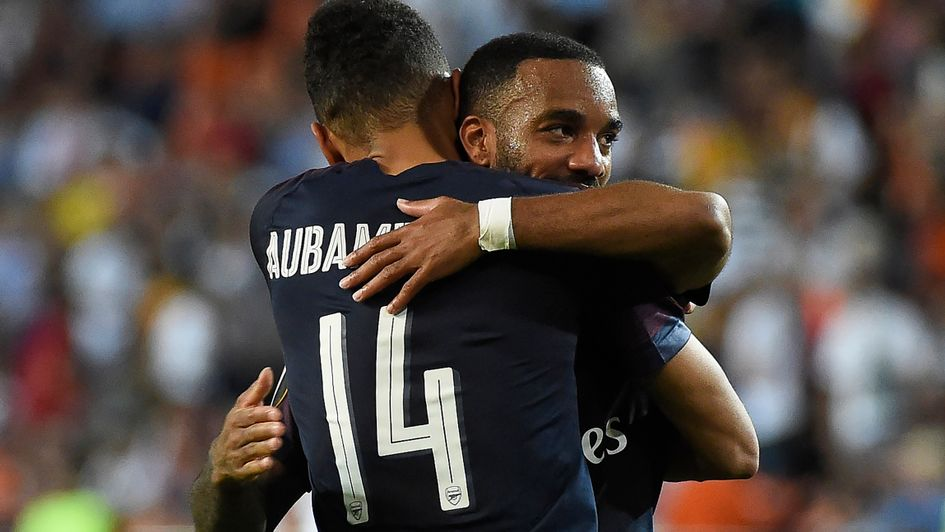 Pierre-Emerick Aubameyang and Alexandre Lacazette celebrate a goal for Arsenal in Valencia