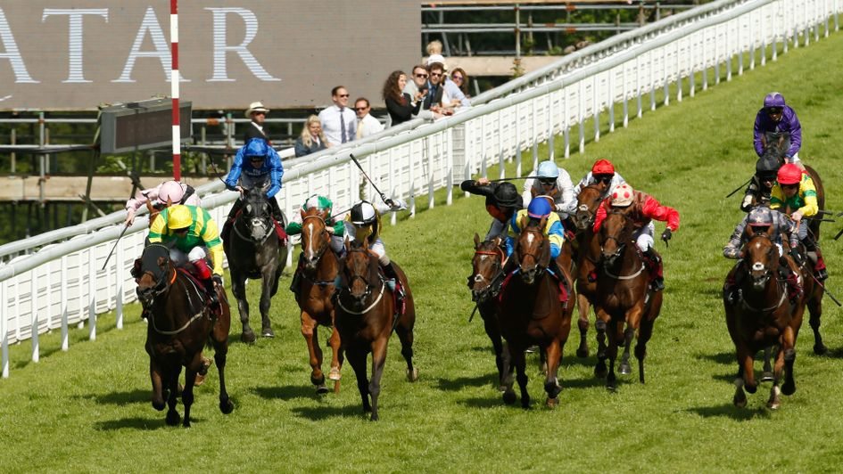 Lancelot Du Lac (yellow cap) lands the Qatar Stewards' Cup