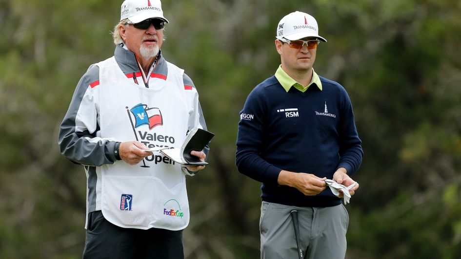 Zach Johnson and his caddie