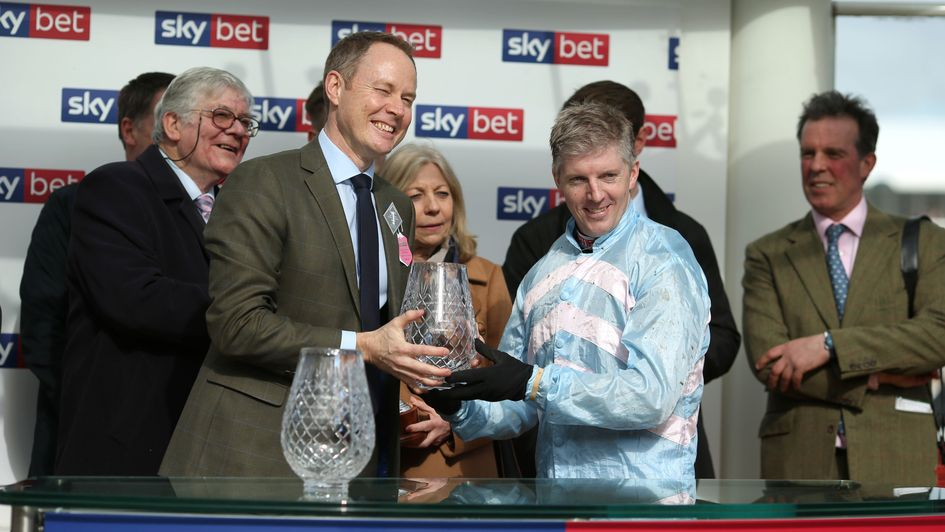 Sky Bet chief executive Richard Flint makes the trophy presentations