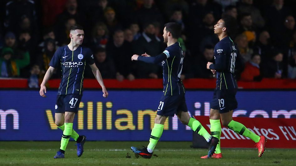 Manchester City celebrate Phil Foden's first of two goals against Newport