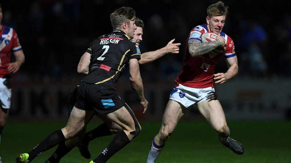 Tom Johnstone (right) looks to go forward for Wakefield