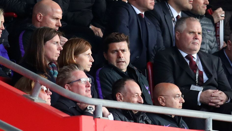 Touchline ban: Spurs boss Mauricio Pochettino watches from the stands at St Mary's