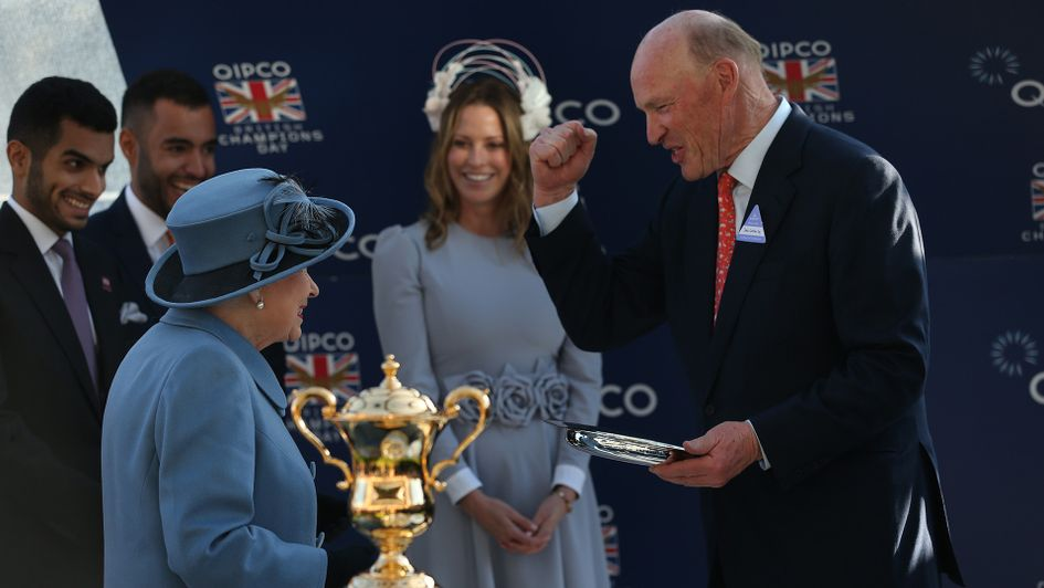 John Gosden collects his QEII trophy from The Queen