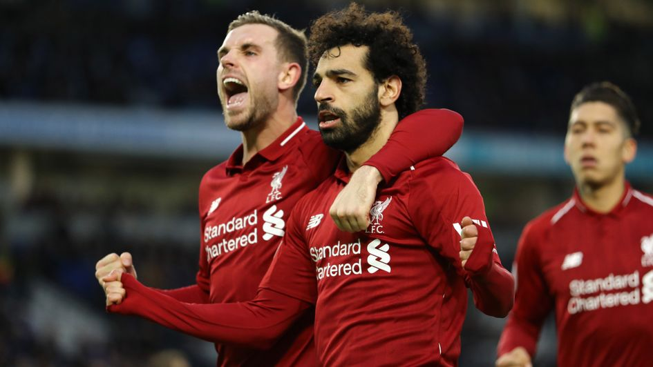 Mo Salah (centre) celebrates his penalty at Brighton with Jordan Henderson (left)