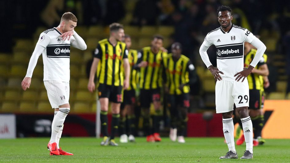 Fulham's Calum Chambers and Andre-Frank Zambo Anguissa look dejected after Watford score