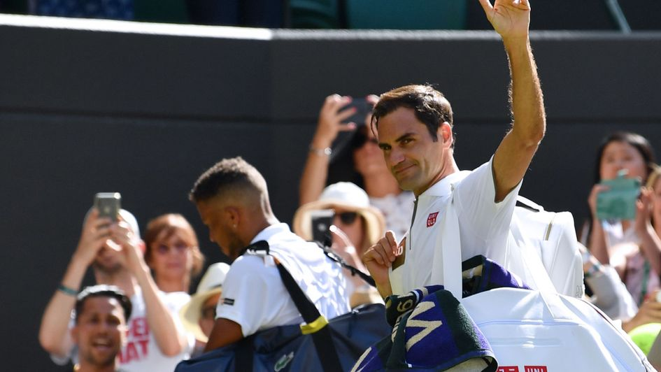 Roger Federer waves to his fans at Wimbledon