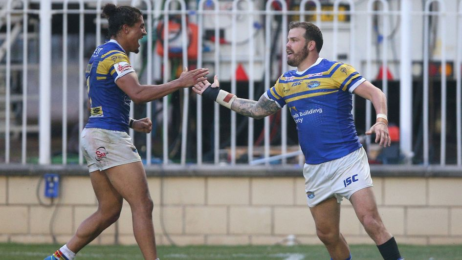 Adam Cuthbertson (right) celebrates with Ashton Golding after a try for Leeds Rhinos