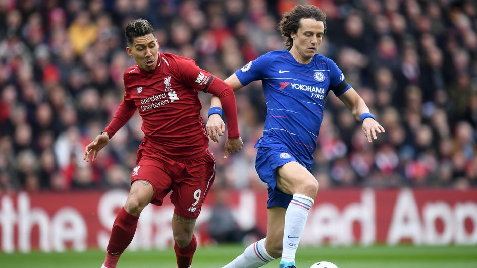 Roberto Firmino (left) and David Luiz battle for the ball
