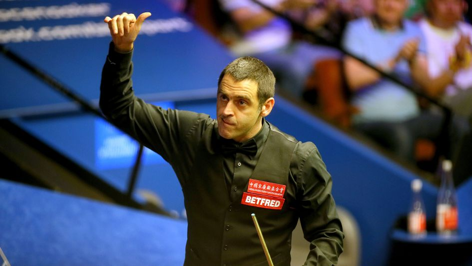Ronnie O'Sullivan celebrates a first-round win over Stephen Maguire