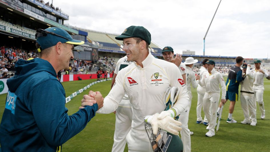 Tim Paine and Justin Langer celebrate