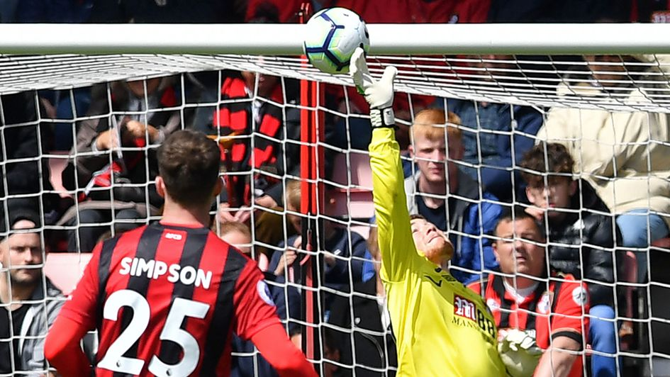 Mark Travers makes a fine save in the Bournemouth goal during his Premier League debut