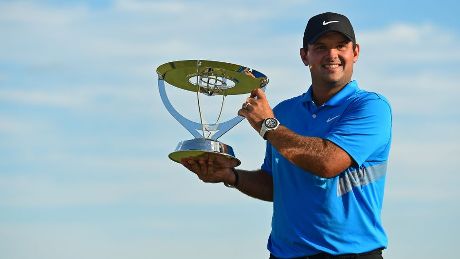 Patrick Reed: The 29-year-old lifts the Northern Trust trophy at the Liberty National Golf Club