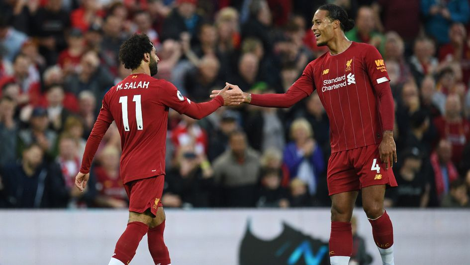 Mo Salah and Virgil van Dijk: Liverpool duo celebrate a goal in the season-opening win over Norwich