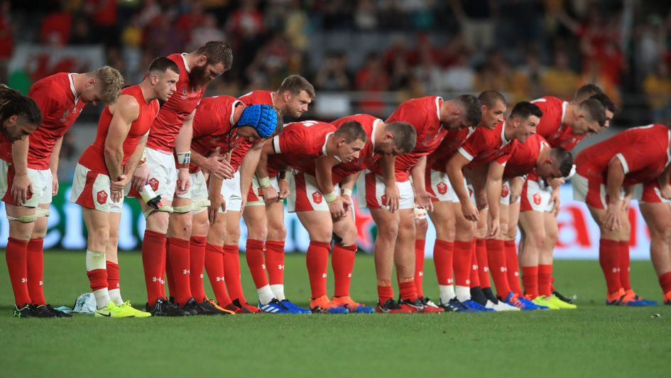 The Wales players bow to the crowd after beating Australia