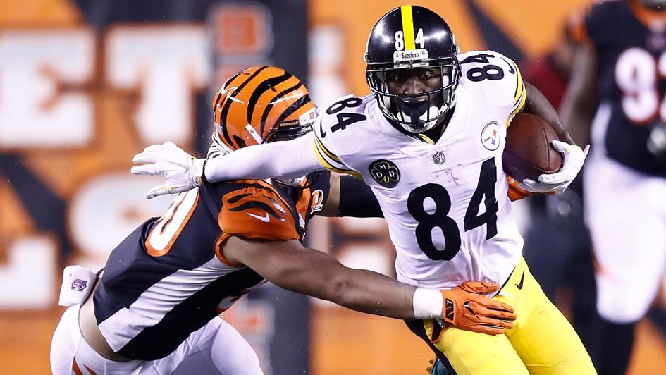 Pittsburgh's Antonio Brown breaks a tackle from Jordan Evans