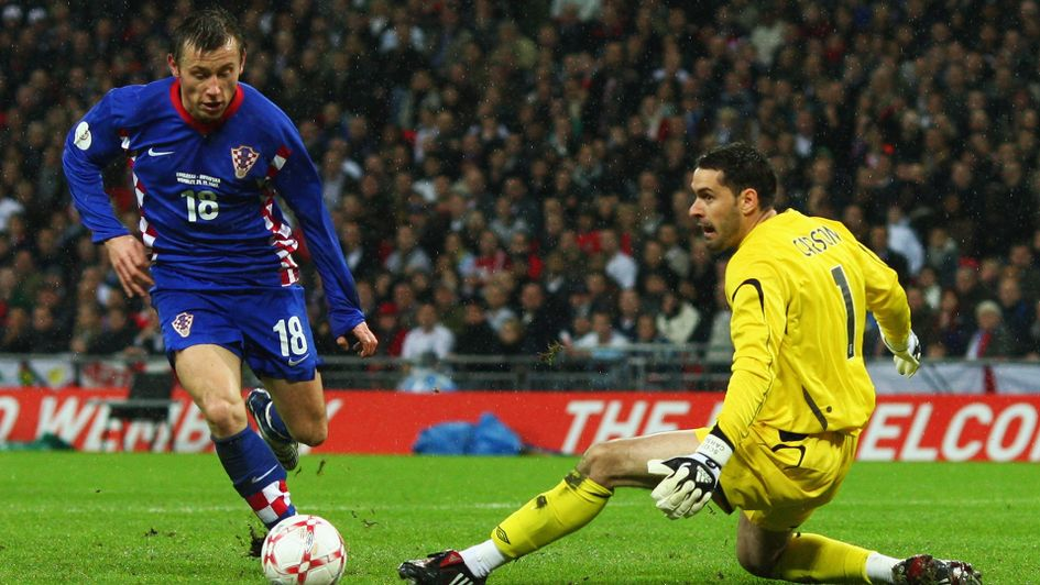 Ivica Olic rounds Scott Carson of England for Croatia's second goal