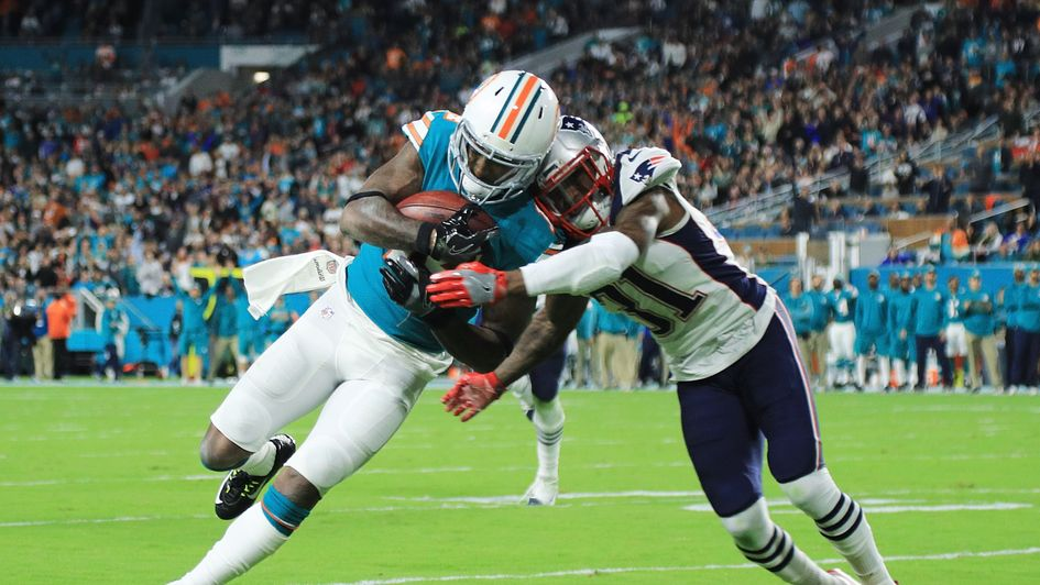 Jarvis Landry of the Miami Dolphins scores a touchdown