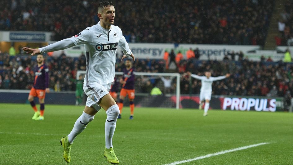 Bersant Celina: The Swansea midfielder celebrates his goal in the FA Cup against former club Man City