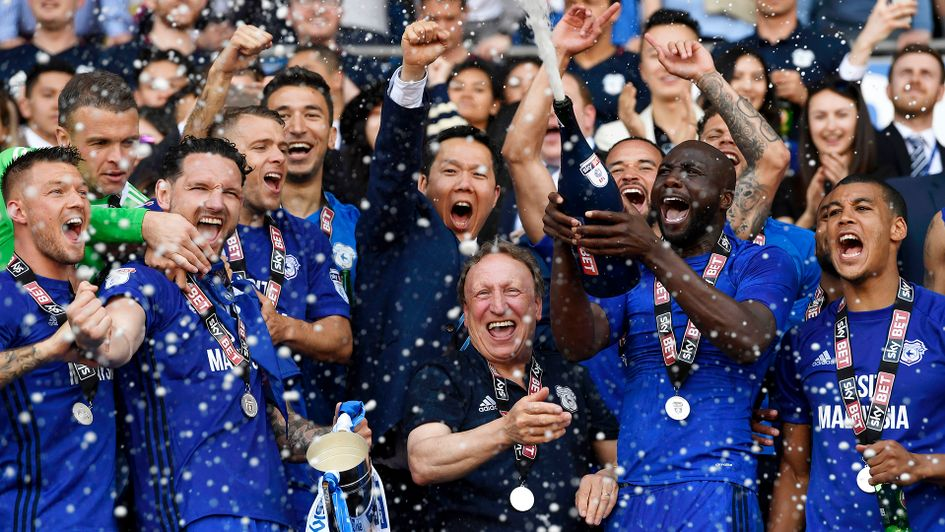 Neil Warnock (centre) celebrates with his players after Cardiff's promotion to the Premier League