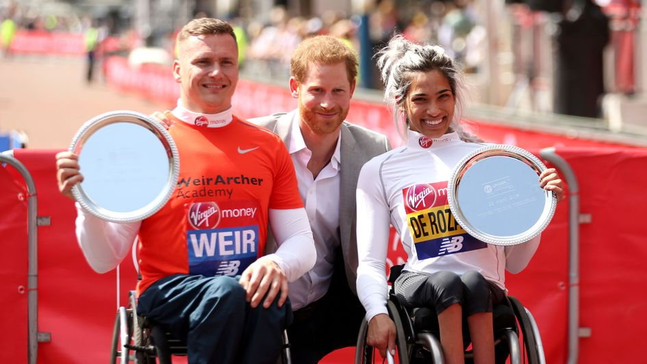 David Weir (left) and Madison de Rozario pose with Prince Harry after the 2018 London Marathon