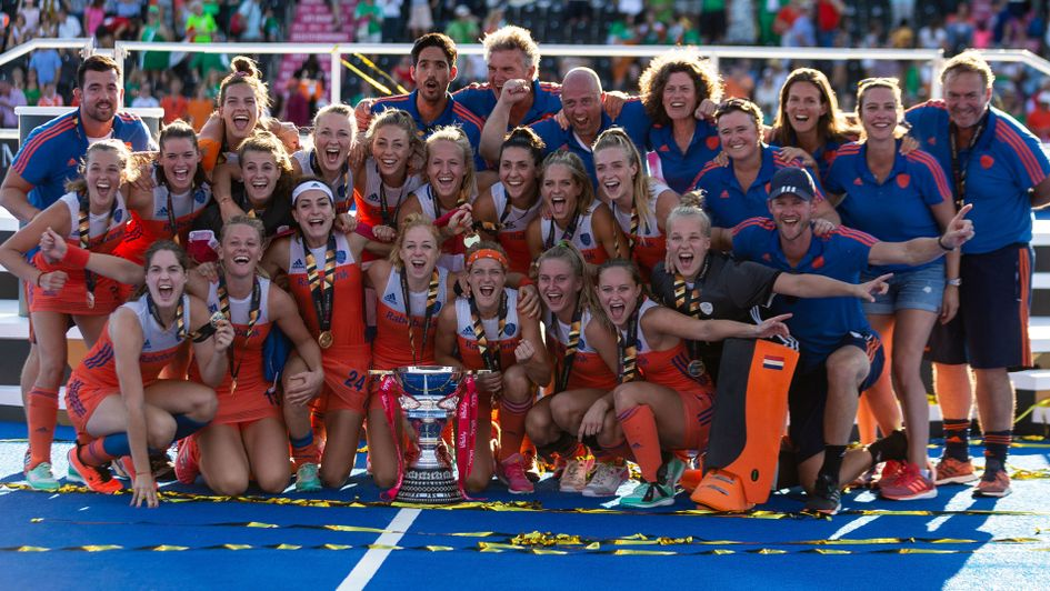 The victorious Netherlands side celebrate with their trophy