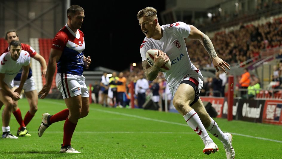 Tom Johnstone scores a try against France