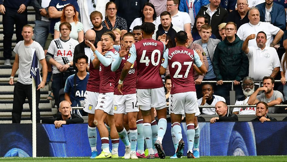 Aston Villa players celebrate John McGinn's goal at Tottenham