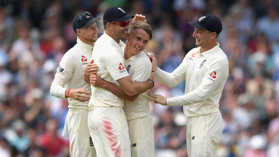 Sam Curran is mobbed by his teammates after taking his first Test wicket