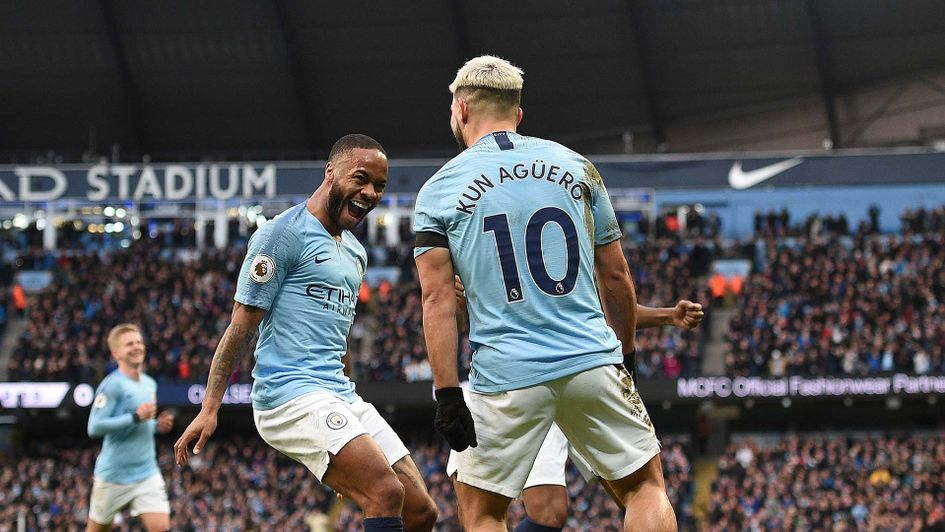 Sergio Aguero celebrates with Raheem Sterling for Manchester City