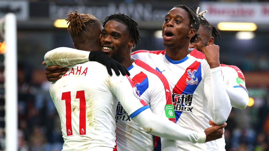 Crystal Palace players celebrate with Wilfried Zaha at Burnley