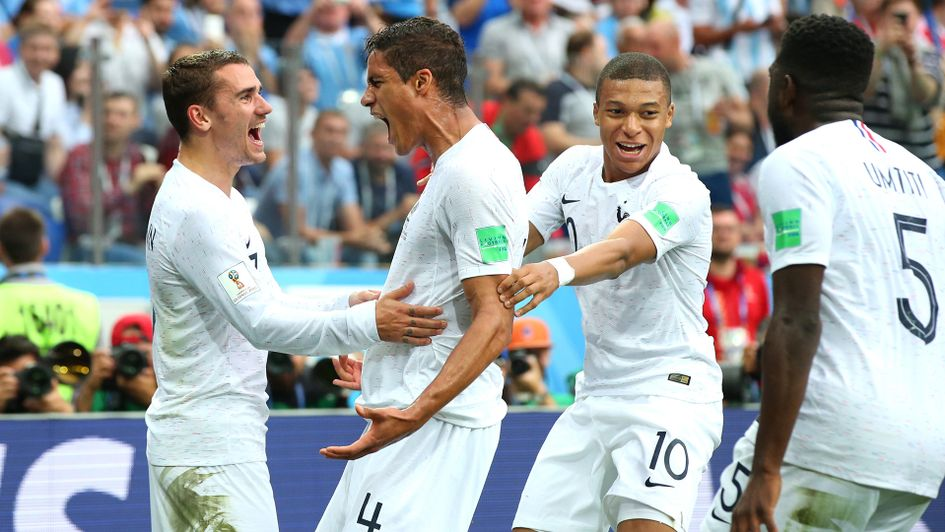 Raphael Varane celebrates his goal against Uruguay