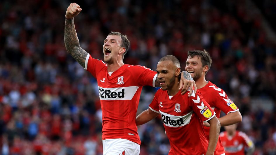 Aden Flint (left) celebrates after scoring against Sheffield United