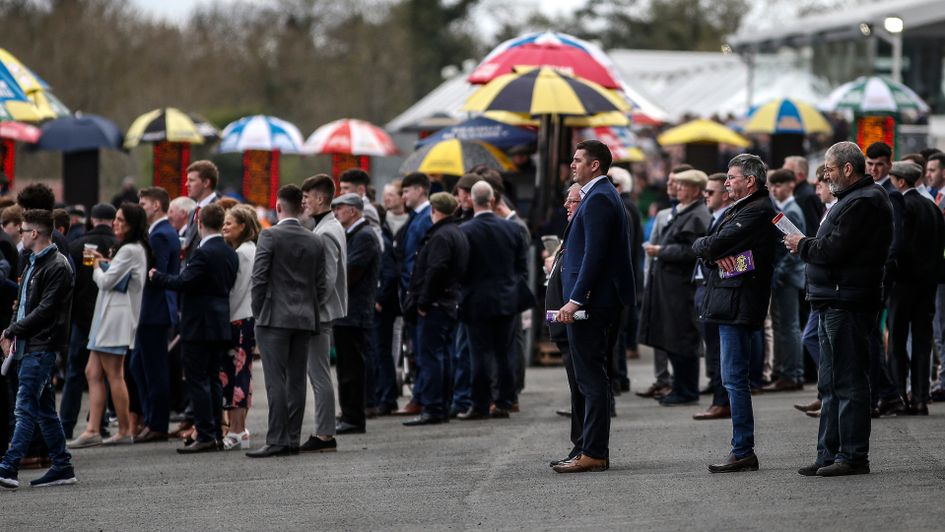Punters weigh up their options at the races