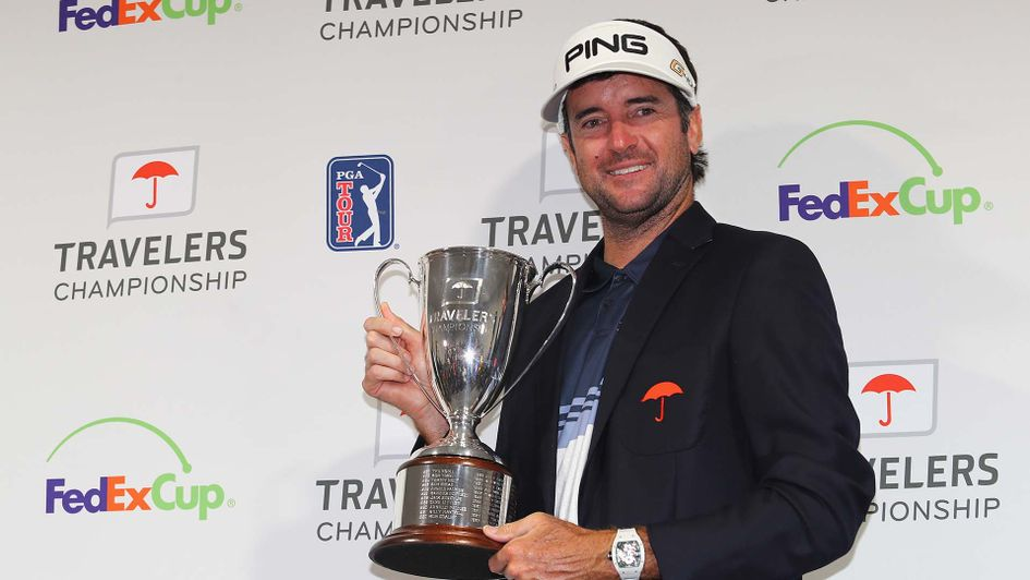 Bubba Watson with the Travelers Championship trophy