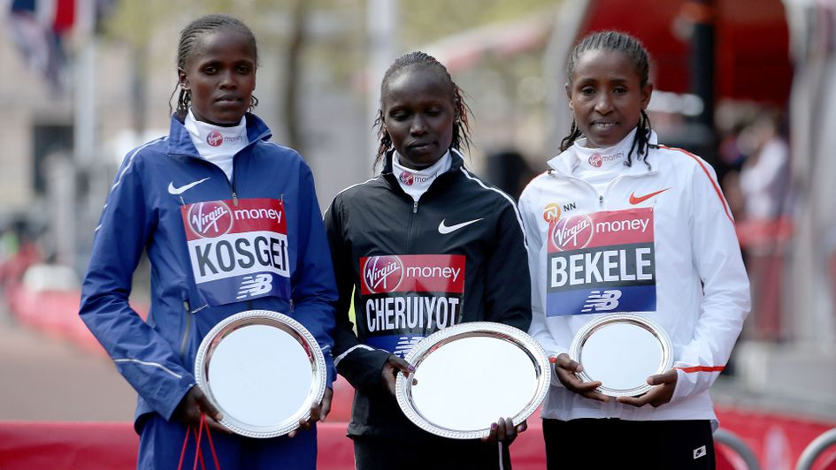 Kenya's Vivan Cheruiyot (centre) poses with the trophy after winning the 2018 Women's London Marathon alongside second placed Kenya's Brigid Kosgei (left) and third placed Ethopia's Tadelech Bekele