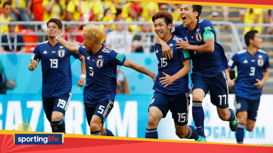 Yuya Osako (second, right) celebrates Japan's World Cup goal with his team-mates